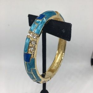 Jewelry - Blue hinged bracelet with rhinestones gold tone